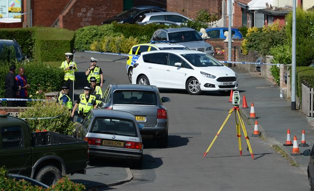 Police survey the scene in Meadow Close in the Trench area of Telford, where the former Aston Villa footballer...