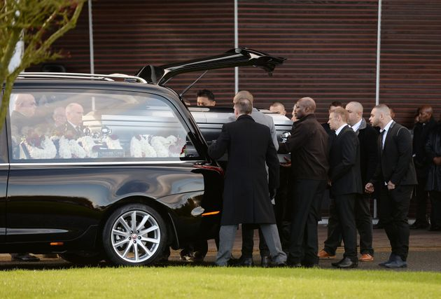The coffin of Dalian Atkinson is carried into Telford Crematorium Chapel for his