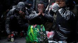 Francia desmantela dos campamentos de migrantes en