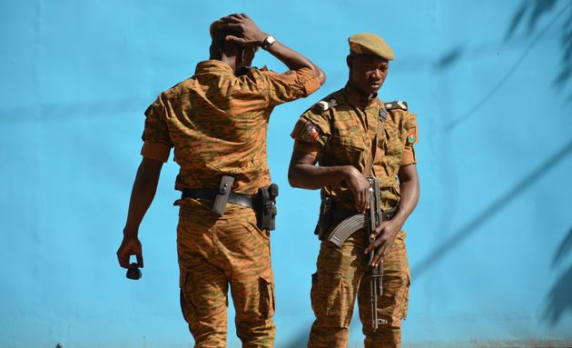 Burkina Faso troops patrol the army'sheadquarters in Ouagadougou on March 3,