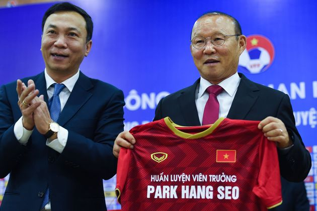 Vietnam's South Korean head coach Park Hang-seo (R) and Vice President of Vietnam Football Federation,...