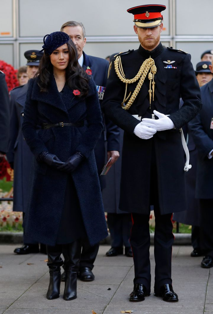 Meghan and Harry stand together during the service.