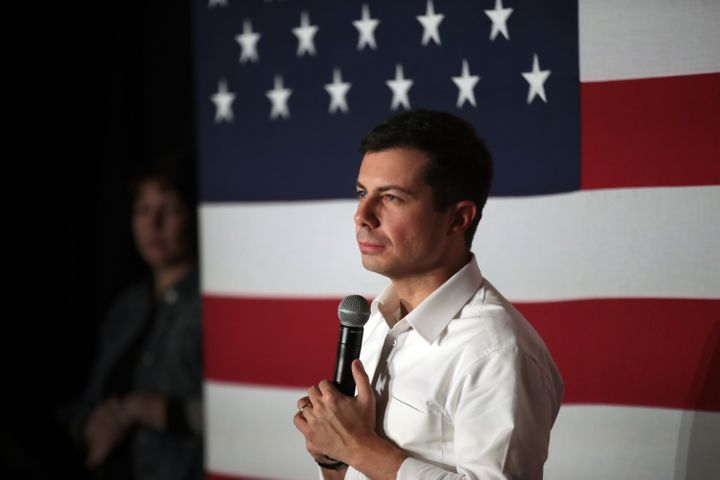 South Bend, Indiana, Mayor Pete Buttigieg speaks to an overflow crowd at an Elks Lodge in Charles City, Iowa, on Sunday. It was the third of six town halls he held in rural northern Iowa.