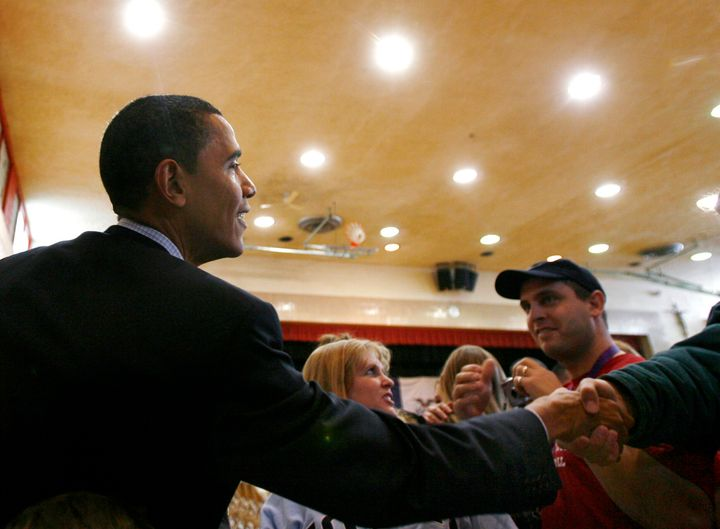 Obama as a presidential candidate, greeting voters during a campaign stop in Mason City, Iowa, in December 2007. Iowa Democra