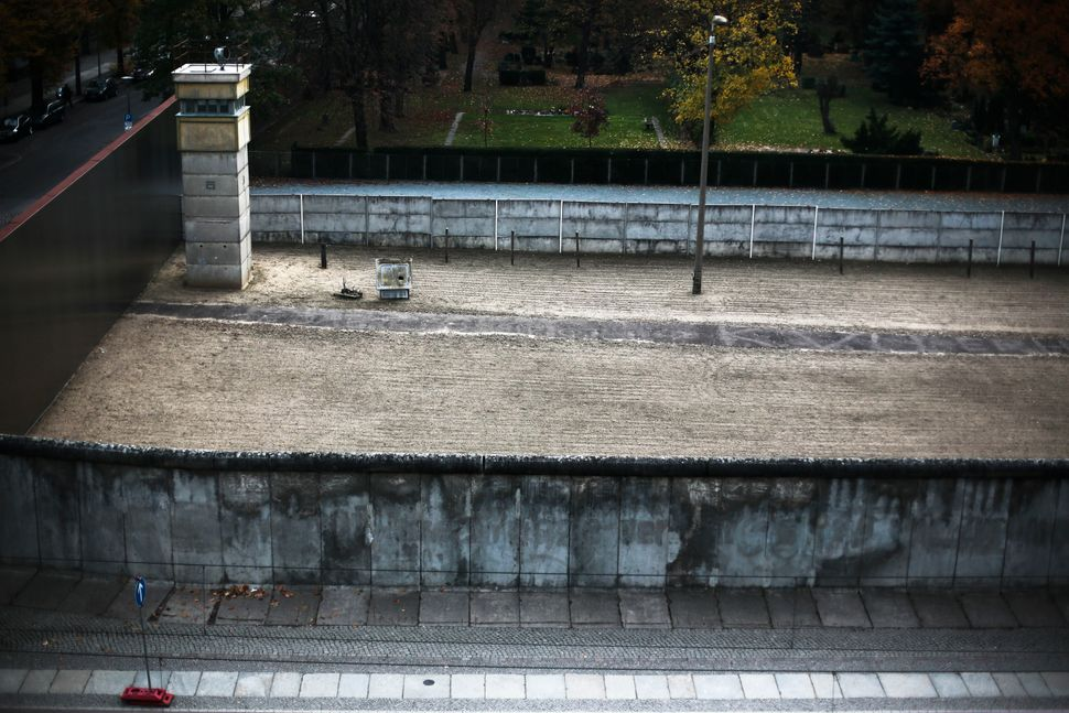 A section of the wall pictured in 2004, kept intact and showing the barricade consisted of two walls...