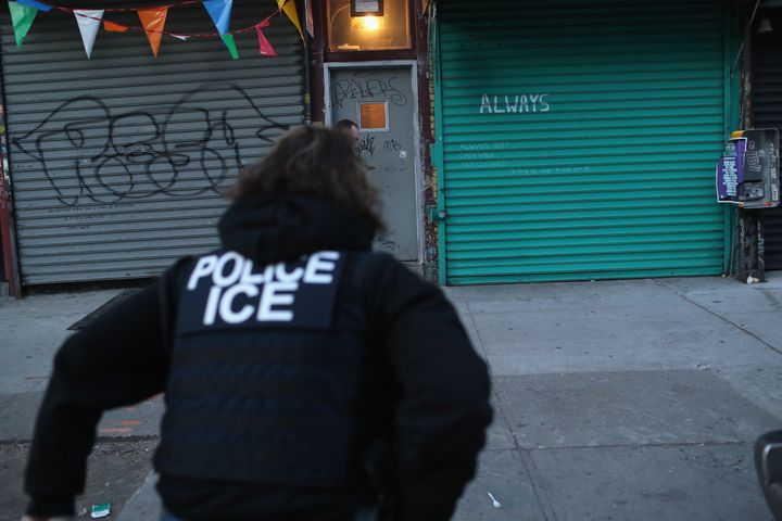 U.S. Immigration and Customs Enforcement officers look to arrest an undocumented immigrant during an operation in the Bushwick neighborhood of Brooklyn on April 11, 2018 in New York City.