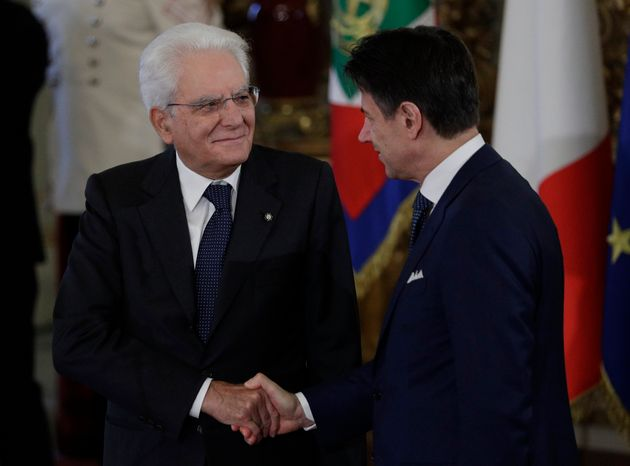 Italian President Sergio Mattarella shakes hands with Prime Minister Giuseppe Conte during the swearing-in...