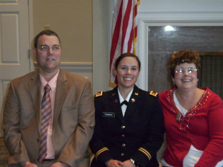 Thomas with her parents at Army National Guard commissioning, May 2011.