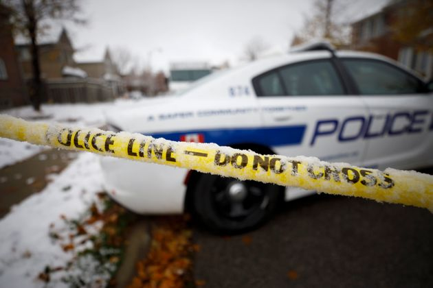Peel Regional Police work the scene around a home in Brampton, Ont., where two boys were found dead on Thursday.