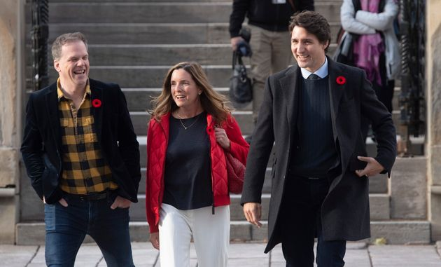 Prime Minister Justin Trudeau laughs with Liberal Party President Suzanne Cowan and Chief Government...