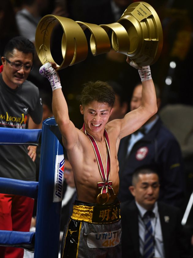 SAITAMA, JAPAN - NOVEMBER 07: Naoya Inoue of Japan celebrates his victory by lifting the Muhammad Ali...