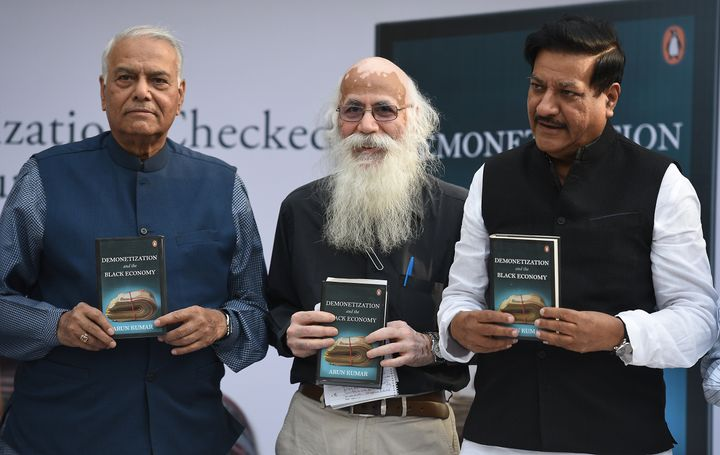 Economist Arun Kumar (centre) with former Minister of Finance Yashwant Sinha (left) and former Chief Minister of Maharashtra Prithviraj Chavan during the launch of his book 'Demonetization and The Black Economy' in New Delhi, India.