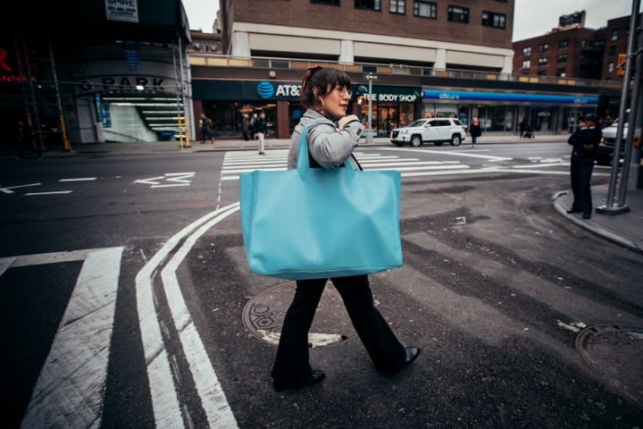 "The writer, midcommute with a massive <a href=""https://vbytownsley.com/collections/eden/products/eden-lagoon-blue-vegan-leather-weekend-tote-bag"" target=""_blank"" rel=""noopener noreferrer"">V by Townsley</a> tote bag in tow."