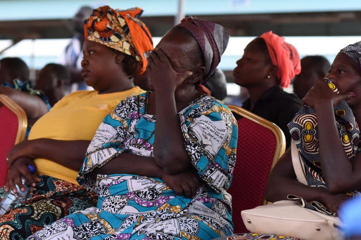 The family members of victims of a deadly ambush attack on workers near a Canadian-owned mine in Burkina Faso react during a meeting with officials in Ouagadougou on Nov. 7, 2019.