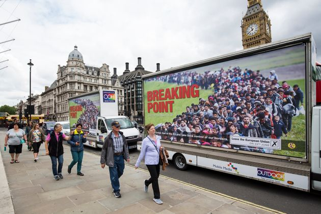 Vans displaying the UK Independence Party's new EU referendum campaign poster near Parliament in June