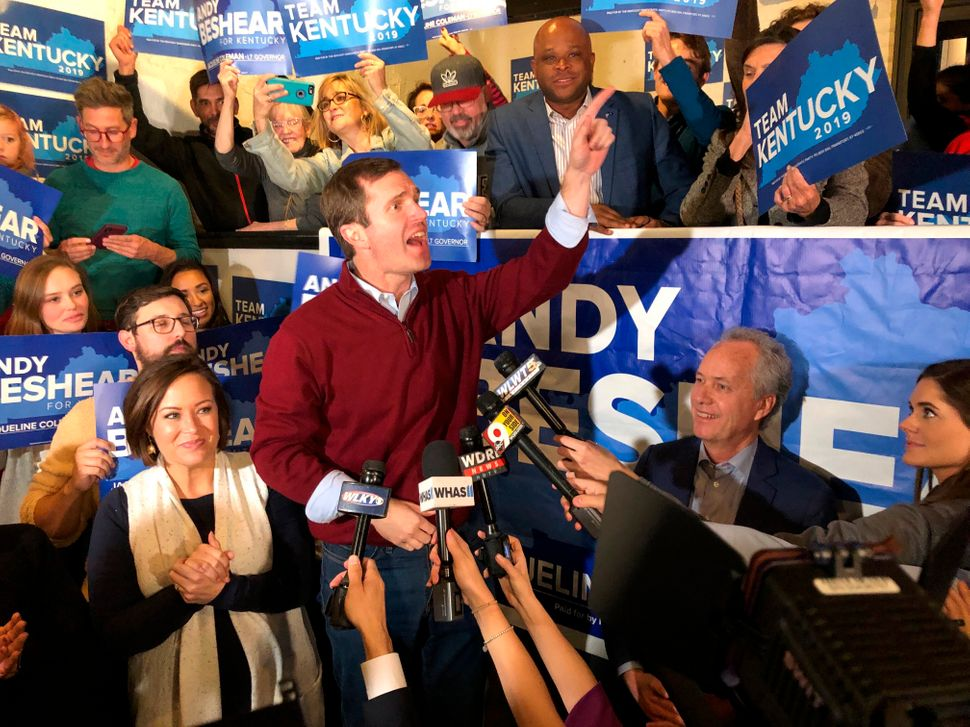 Democrat Andy Beshear speaks to supporters after a daylong tour of Kentucky on the last night of the campaign for governor, i