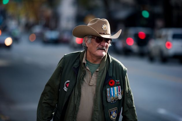 Aboriginal Canadian Army veteran, David Ward, leads the way while marching during an Aboriginal Veterans Day ceremony in Vancouver on Friday.