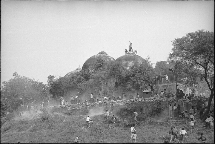 Karsevaks atop the Babri masjid shortly before it was demolished on December 6, 1992 in Ayodhya.