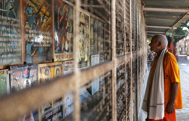 A Hindu devotee looks at an exhibition about the history of demolished Babri mosque in Ayodhya, October...