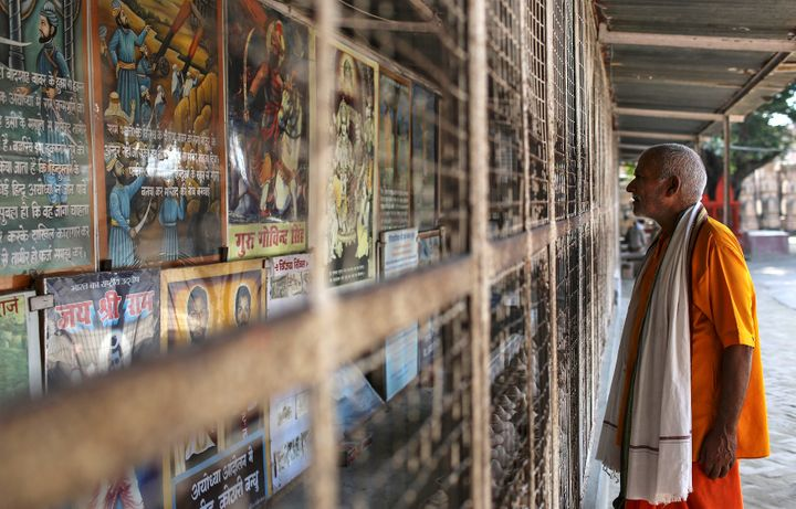 A Hindu devotee looks at an exhibition about the history of demolished Babri mosque in Ayodhya, October 22, 2019.