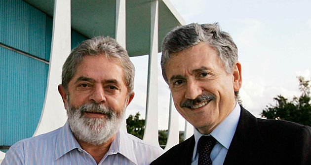 Brazil's President Luiz Inacio Lula da Silva (L) and Italy's Foreign Minister Massimo D'Alema shake hands...