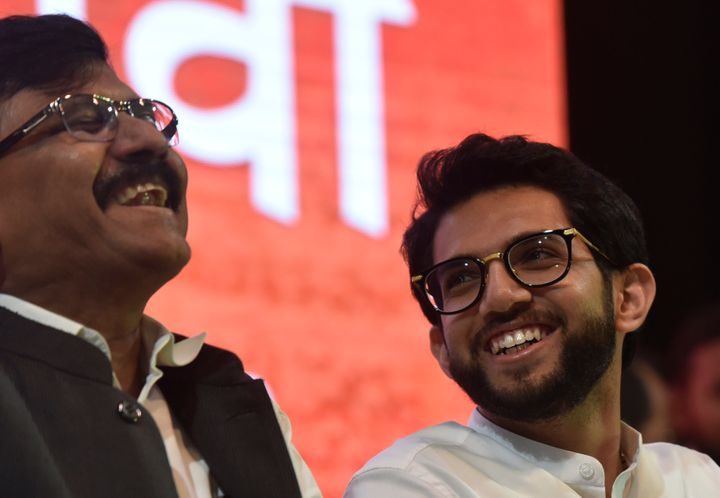 MUMBAI, INDIA - SEPTEMBER 30: Yuva Sena President Aaditya Thackeray and Shiv Sena leader Sanjay Raut share a light moment during a party rally at Worli, on September 30, 2019 in Mumbai, India. While addressing the rally Thackeray announced that he will take the electoral plunge in the upcoming Assembly elections and contest from the Worli constituency in Mumbai. (Photo by Kunal Patil/Hindustan Times via Getty Images)
