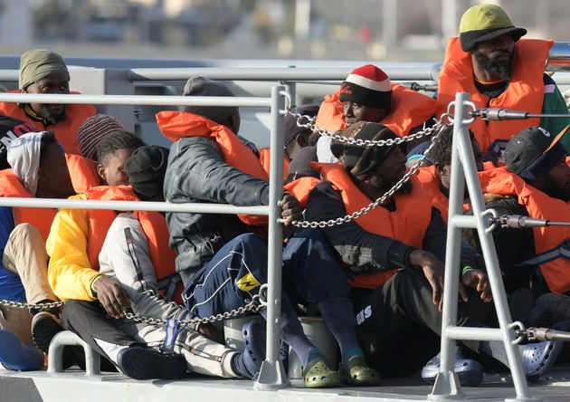 Some of the migrants who were stuck on a ship since their rescue in the Mediterranean 10 days ago, arrive...