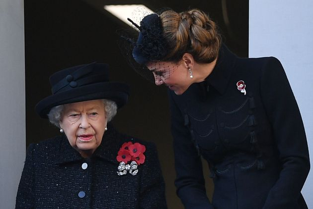 Britain's Queen Elizabeth II (L) talks with Britain's Catherine, Duchess of Cambridge, (R) as they attend...