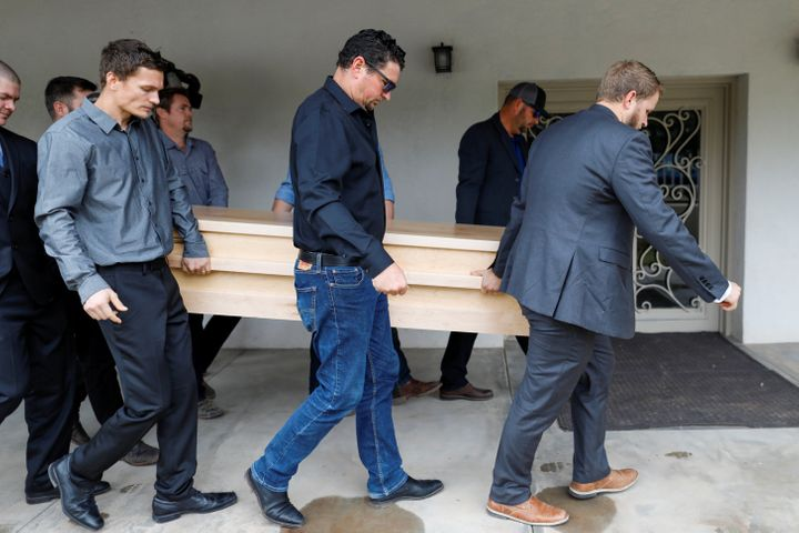 Relatives of Christina Marie Langford Johnson, who was killed by unknown assailants, carry her coffin during the funeral serv