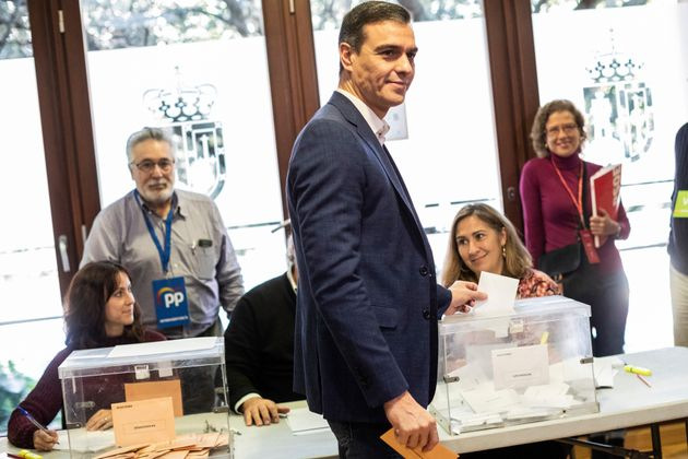 Spain's caretaker Prime Minister and socialist candidate Pedro Sanchez casts his vote for the general...