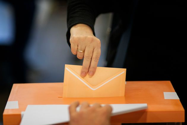 A woman casts her vote for the general election in Barcelona, Spain, Sunday, Nov.10, 2019. Spain holds...