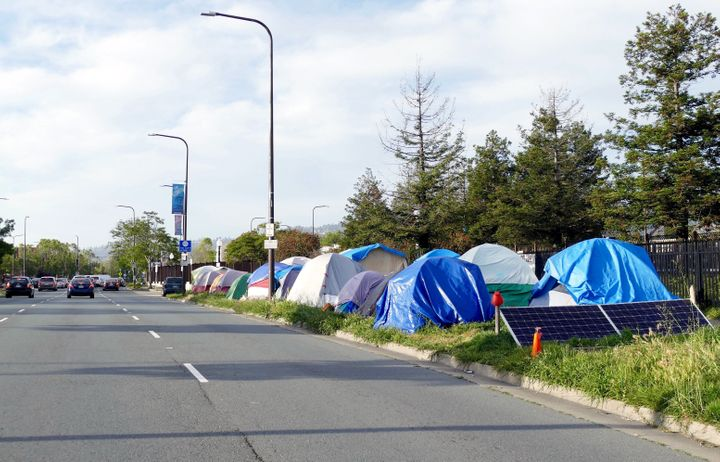 Tent City on the edge of Adeline Street in Berkeley, California. The tech boom in the San Francisco area has provided the reg