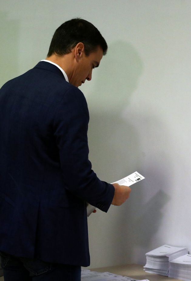 Spain's acting Prime Minister and Socialist Party (PSOE) leader and candidate Pedro Sanchez picks up...