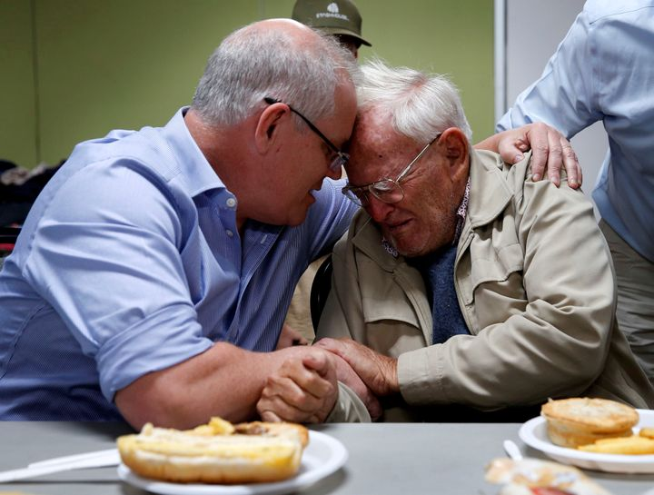 Australia's Prime Minister Scott Morrison comforts 85-year-old evacuee Owen Whalan during a visit to Club Taree Evacuation Centre in Taree.