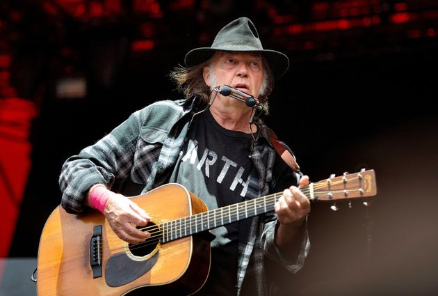 Neil Young performs at the Roskilde Festival in Denmark, on July 1,