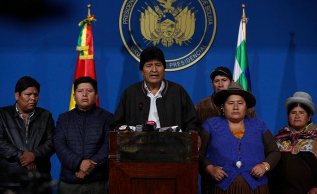 Bolivia's President Evo Morales, center, speaks during a press conference at the military base in El...