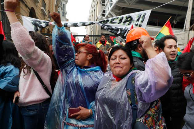 Opponents of Bolivia's President Evo Morales celebrate after he announced his resignation, in La Paz,...