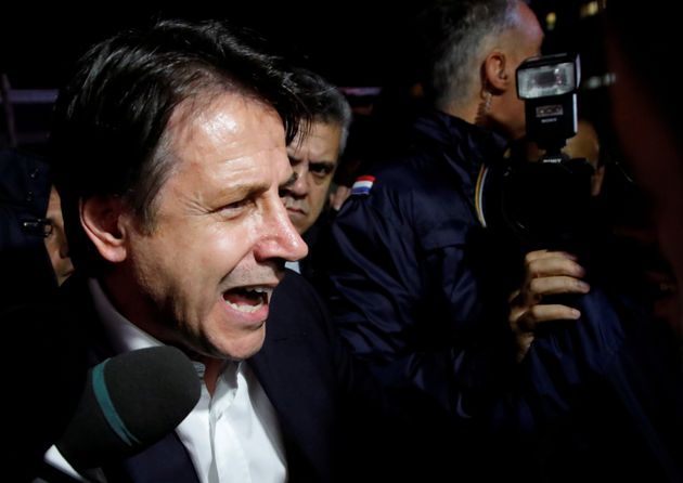 Italian Prime Minister Giuseppe Conte speaks to protesters as he visits the Ilva steel plant, which ArcelorMittal...