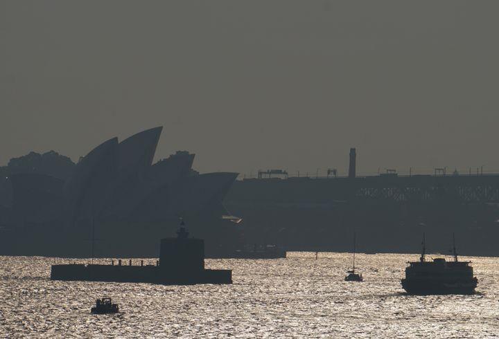 The Sydney Opera House is seen through smoke from bushfires in Sydney, Australia, November 11, 2019.