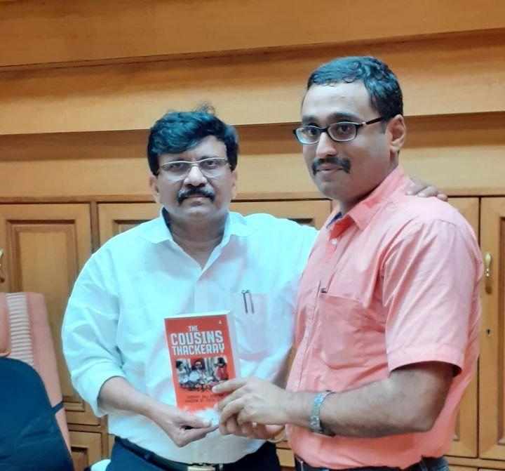 Writer Dhaval Kulkarni with Shiv Sena leader Sanjay Raut