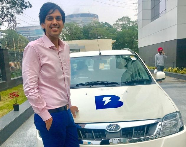 Blu Smart's founder Punit Goyal along with one of the electric cars on the