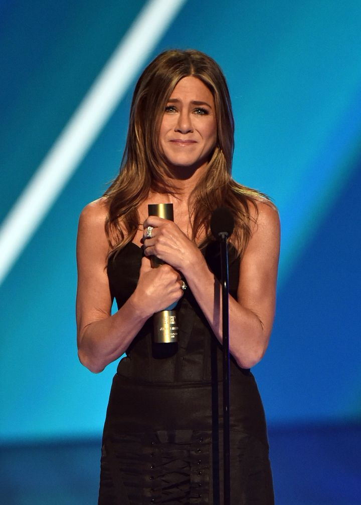 Jennifer Aniston accepts The People's Icon of 2019 award on stage during the E! People's Choice Awards