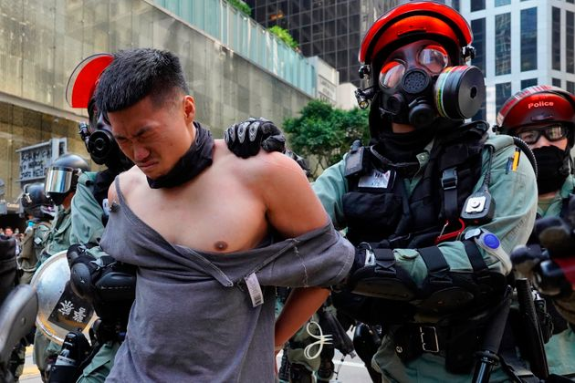 A protester is detained in Central district of Hong Kong on Monday, Nov. 11, 2019. A Hong Kong protester...