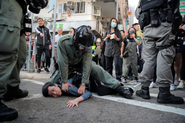 A protester is detained in Hong Kong Monday, Nov. 11, 2019. Hong Kong is in the sixth month of protests...