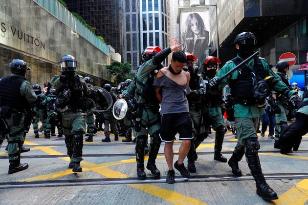 A protester, center, is detained in Central district of Hong Kong on Monday, Nov. 11, 2019. A Hong Kong...