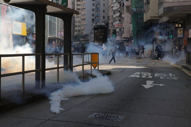 Tear gas fills the streets of Hong Kong Monday, Nov. 11, 2019. Police in Hong Kong have shot a protester...