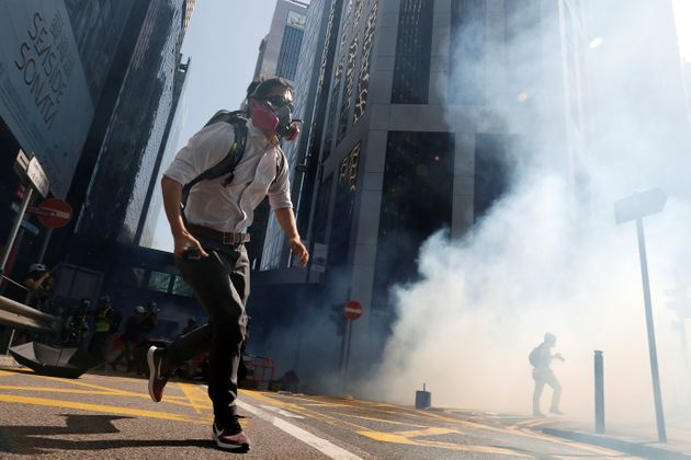 A protester runs after police fired tear gas in Hong Kong on