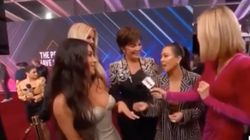 Kim Kardashian Tries To 'Save' Kourtney In Awkward Red Carpet