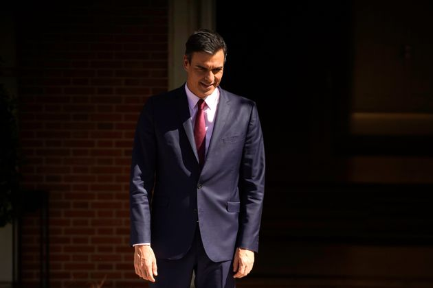 Spain's acting Prime Minister Pedro Sanchez leaves his office as he waits for the arrival of Unidas Podemos'...