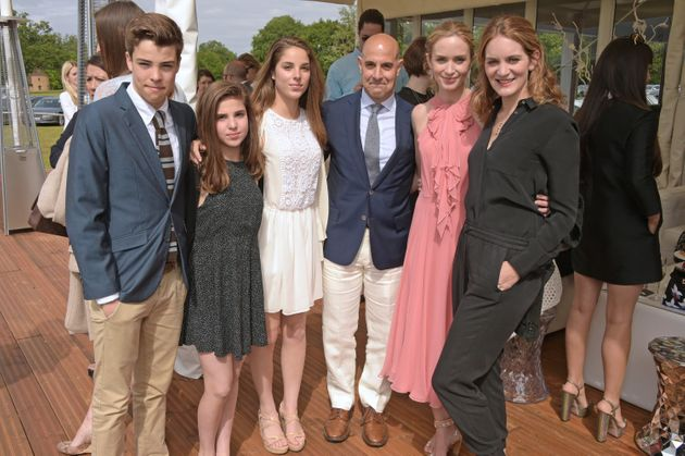 Tucci with his three oldest children, Emily Blunt and Felicity Blunt at the Audi Polo Challenge at Coworth...